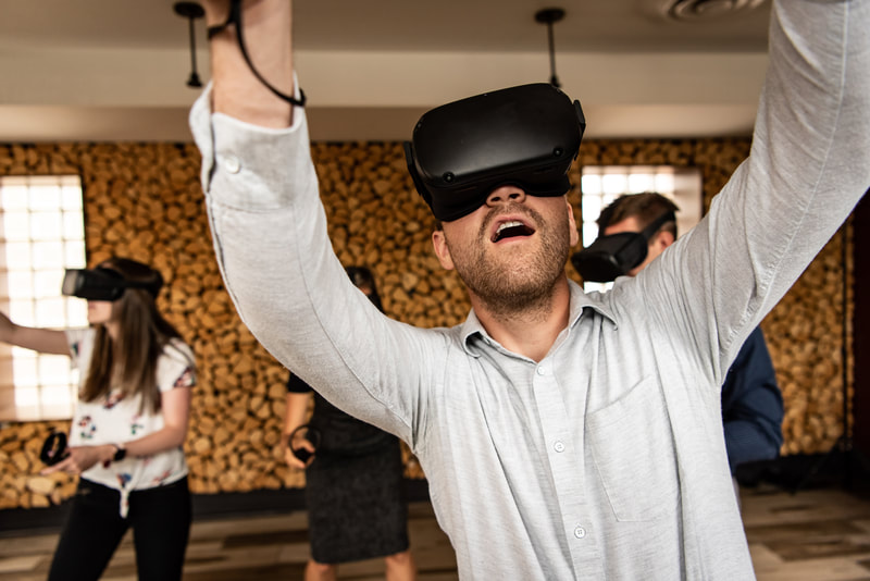 Group of people undergoing a VR coaching session