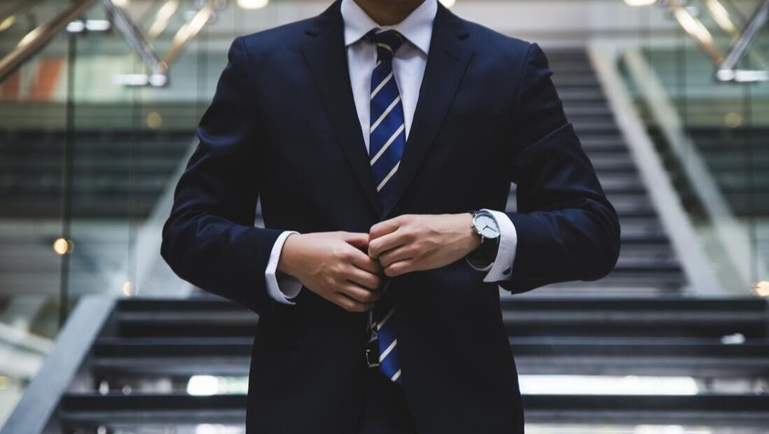 Photo of a man in a suit representing a recruitment firm